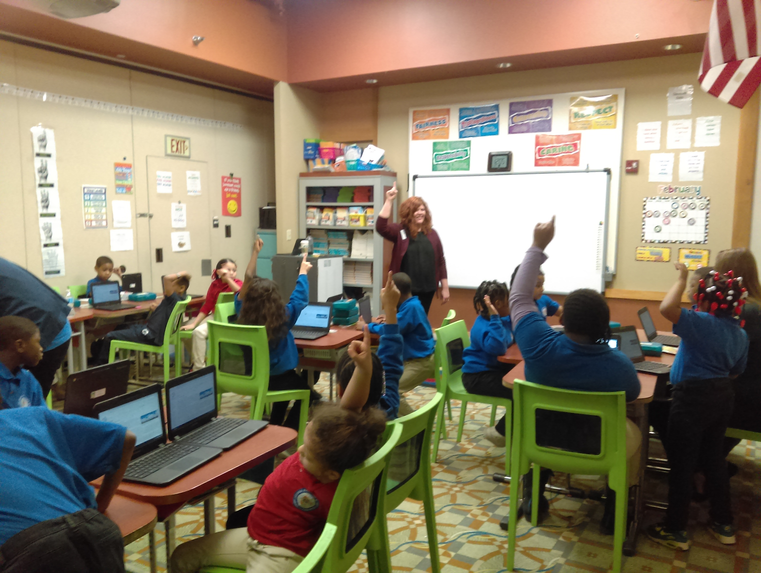 Rachel Herron leading a group of elementary students in a classroom