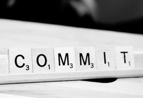 Scrabble letter tiles in spell the word commit